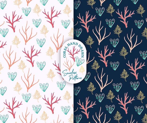 Bellissimo stile corallo disegnato a mano con motivo senza cuciture rosa e blu marino