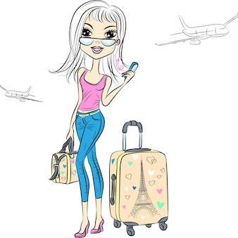 Bella ragazza di moda con le valigie viaggia per il mondo sugli aeroplani