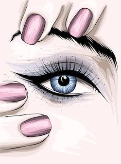 Bella manicure e trucco degli occhi femminili