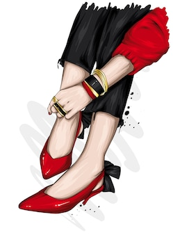 Bei piedini femminili in eleganti scarpe a tacco alto.