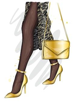 Bei piedini femminili in scarpe e borsa alla moda