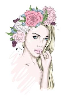 Bella ragazza in una corona di fiori
