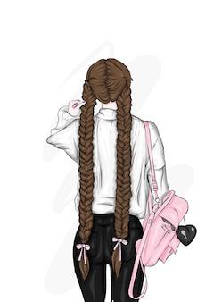 Bella ragazza in vestiti alla moda