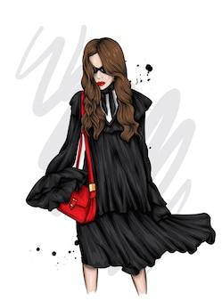 Bella ragazza in un vestito alla moda