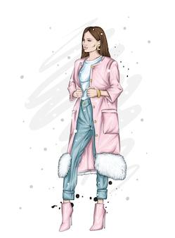 Bella ragazza in abiti invernali alla moda