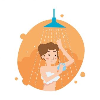 La bella ragazza lava il corpo nella doccia