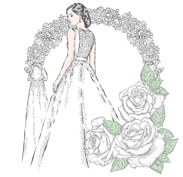 Bella ragazza in abito da sposa e con fiori