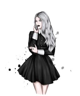 Bella ragazza con i capelli lunghi in un vestito alla moda