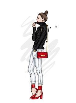Bella alta in pantaloni e una felpa. vestiti e accessori alla moda.