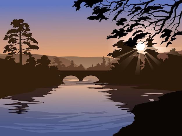 Bella scena mattutina al fiume con ponte e alberi
