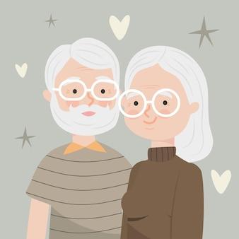 Bella vecchia coppia con cuori decorativi intorno