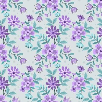 Bellissimi fiori viola e foglie verdi senza cuciture.