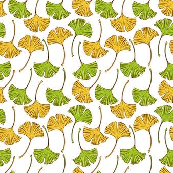 Bello modello senza cuciture con foglie gialle e verdi del ginkgo. illustrazione disegnata a mano