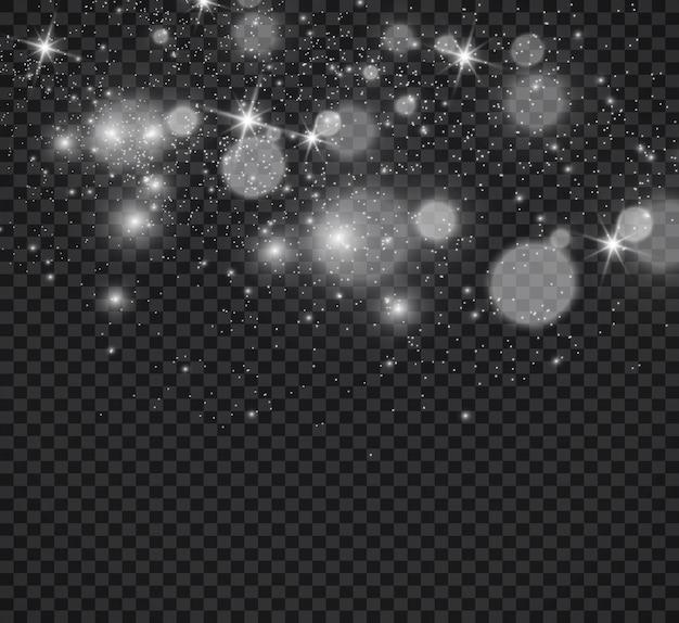 Bellissime scintille brillano con speciali scintillii di luce su uno sfondo trasparente natale ab