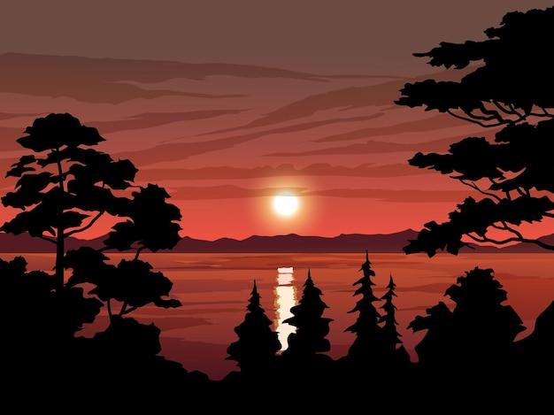 Bel tramonto nel lago con silhouette albero