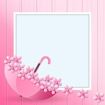 Bello ombrello e fiore dentro su colore rosa