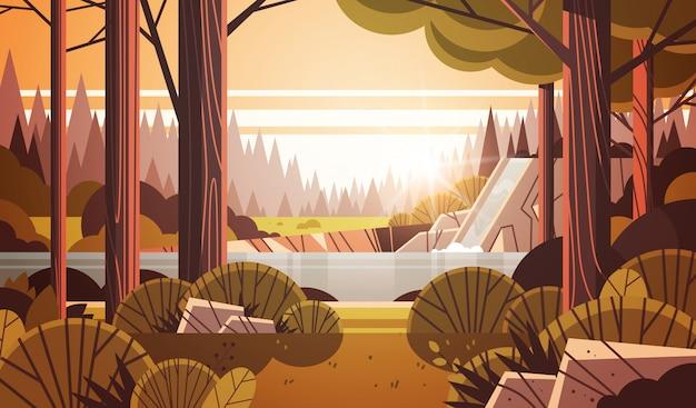 Bella cascata sulla scogliera rocciosa giallo autunno foresta paesaggio naturale