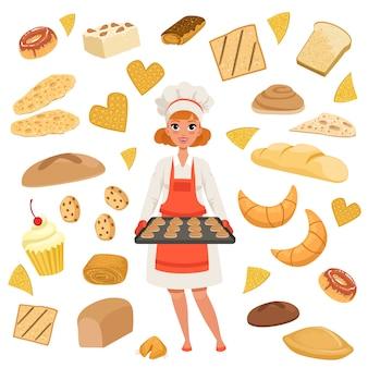 Panettiere bello della donna che sta con un vassoio di cottura con i biscotti.