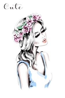 Bella donna con ghirlanda di fiori tra i capelli