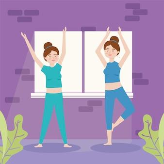 Belle donne che praticano la posa dell'albero di yoga