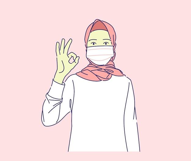 Bella giovane donna musulmana che indossa la maschera facendo segno ok con il concetto di illustrazione disegnata a mano di vettore del dito