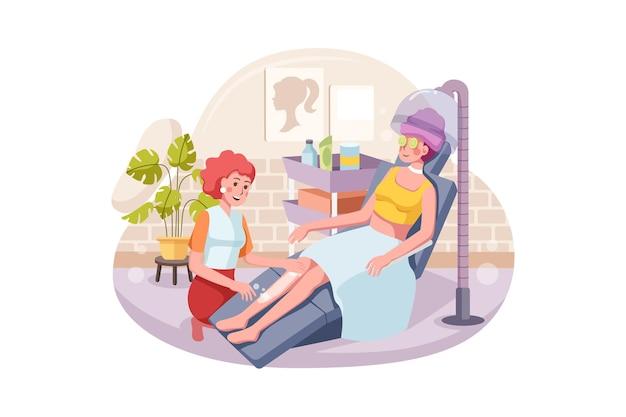 Bella giovane donna che fa massaggio con scrub corpo nel salone della stazione termale
