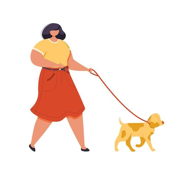 Bella giovane donna vestita con abiti colorati che camminano cane al guinzaglio.
