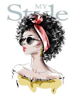 Bella giovane donna con l'acconciatura afro