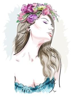 Bella giovane donna con capelli ricci e ghirlanda di fiori