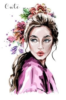 Bella giovane donna con i fiori