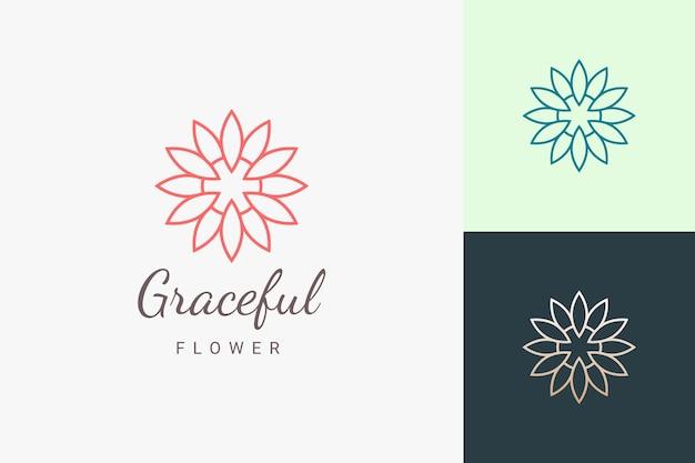 Logo per cure di bellezza o salone a forma di fiore di lusso e femminile