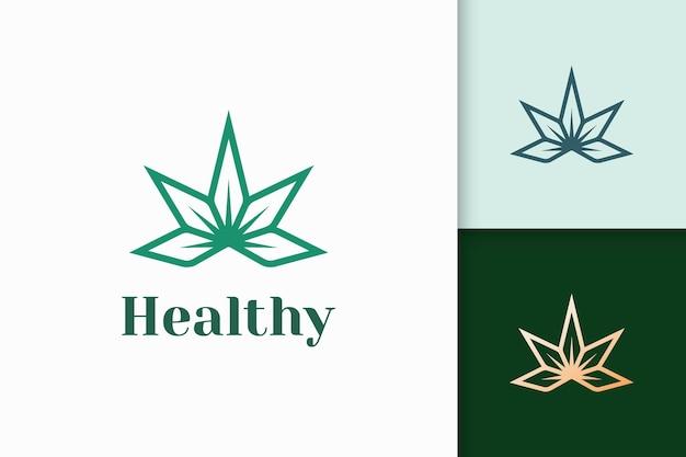 Logo di bellezza o salute a forma di fiore adatto per cosmetici o spa