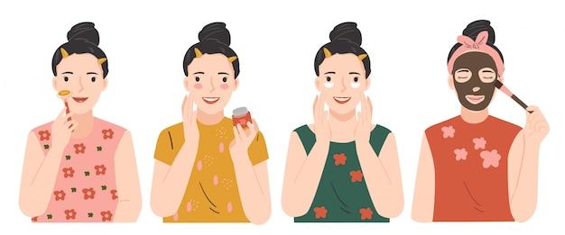 Routine di bellezza per la cura della pelle. procedure di bellezza concetto di cura della pelle. massaggio detergente, idratante, viso con rullo. giovane donna che applica la maschera facciale dell'argilla del fango grigio al suo fronte.