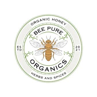 Logo dell'ape con emblema delle foglie vettore premium