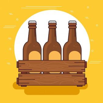 Le birre hanno messo nella scatola di legno, su fondo giallo