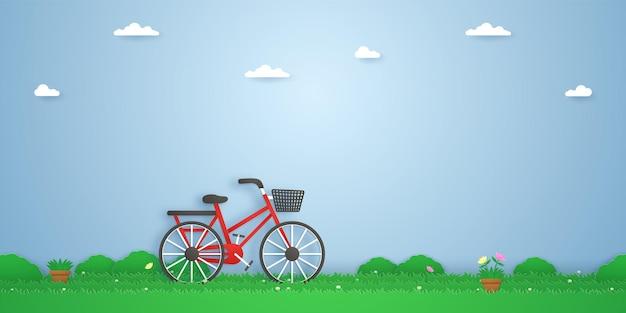 Bicicletta in giardino, vasi per piante e bellissimi fiori sull'erba, stile arte della carta