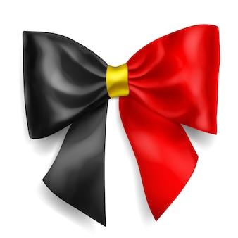 Grande fiocco fatto di nastro nei colori della bandiera del belgio con ombra su sfondo bianco