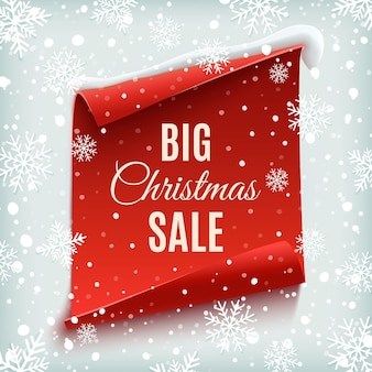 Grande poster di vendita di natale. rosso, curvo, striscione di carta su sfondo invernale con neve e fiocchi di neve.