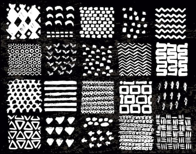Grande raccolta di diverse trame fatte in casa realizzate con inchiostro su sfondo nero