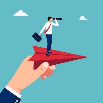 Grande mano che tiene l'aereo di carta rosso con uomo d'affari in piedi su di esso concetto illustrazione.