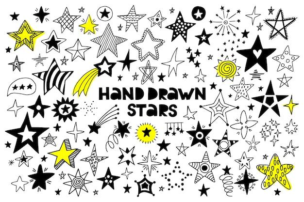 Grande insieme delle stelle disegnate a mano su bianco