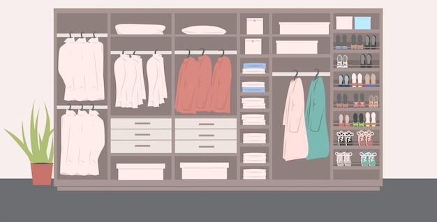 Grande armadio con diverse scarpe alla moda e vestiti all'interno moderno spogliatoio interno orizzontale