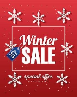Grande poster di vendita invernale con etichetta blu appesa e illustrazione di fiocchi di neve