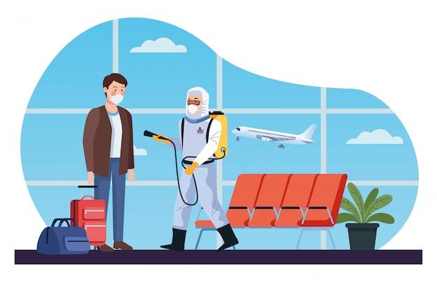 L'operatore di biosicurezza disinfetta l'aeroporto per