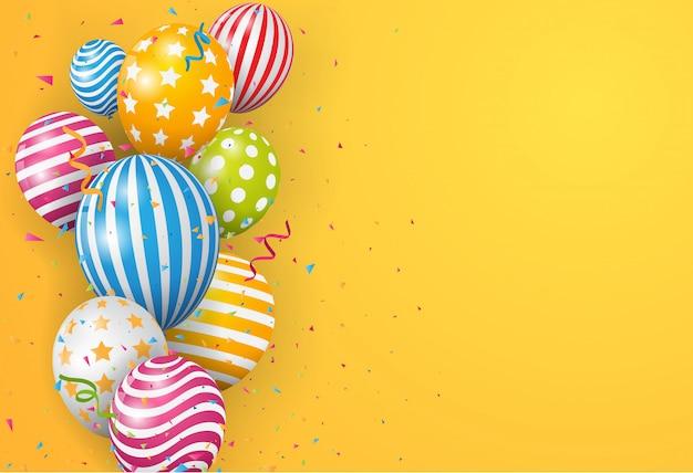 Palloncino di compleanno con coriandoli colorati su sfondo arancione