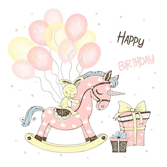 Biglietto d'auguri per una ragazza con un cavallo giocattolo unicorno e palloncini e regali.