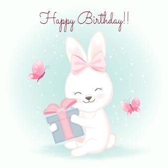 Biglietto di auguri per il compleanno con coniglio e regalo, illustrazione disegnata a mano dell'acquerello del fumetto