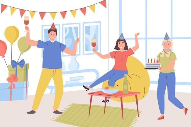 Concetto di festa di compleanno a casa l'uomo e la donna in cappelli festosi si divertono a congratularsi