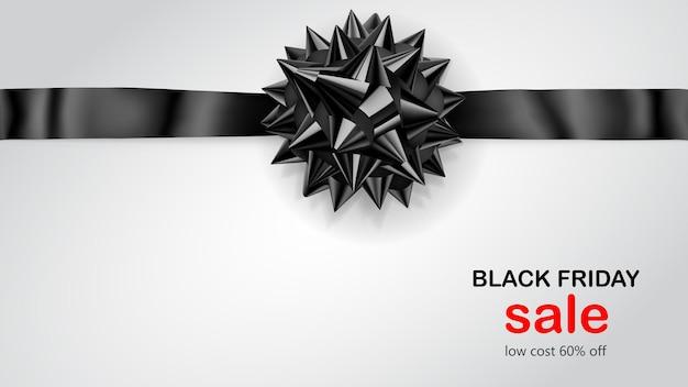 Fiocco nero con nastro orizzontale con ombra e scritta black friday sale su sfondo bianco