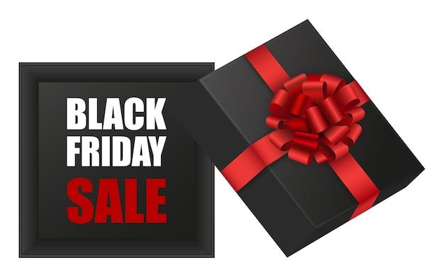 Confezione regalo venerdì nero. scatola nera aperta con fiocco rosso e nastro